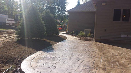 Quicker Property Services - North Royalton, Ohio - Concrete Driveways, Sidewalks, Concrete Parking Lots, Stamped Concrete Patios, Basement Waterproofing