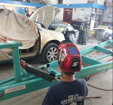 Fine Line Auto Body and Towing - Cleveland, Ohio - Tires, Batteries, Auto Body Repair & Painting, Auto Repair, Exhausts, Brakes, Towing and more
